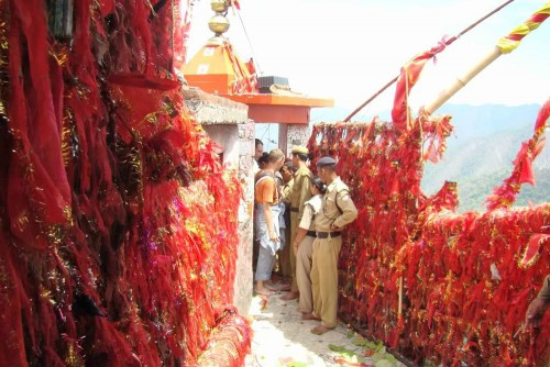 The red ribbons are a part of the prasad offering of pilgrims, many of these would have been made by Raju's hands...