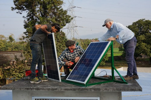 Sunny, Rick and volunteer Winston from Tasmania setting up solar panels.