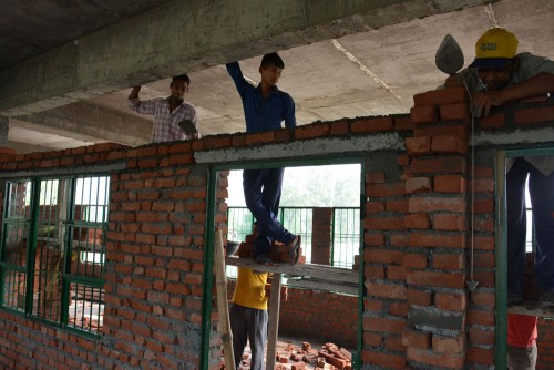 Constructing the internal walls of the first floor.