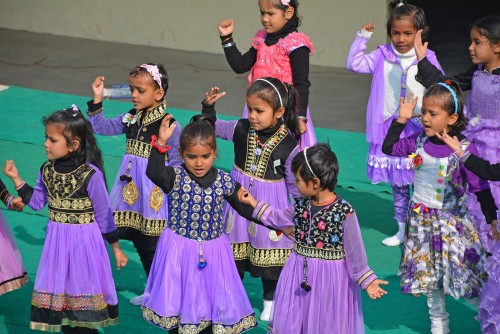 Children dancing as part of the opening celebration.