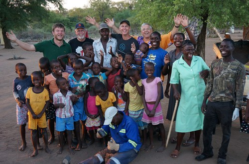 Clifton and John with new friends in Africa