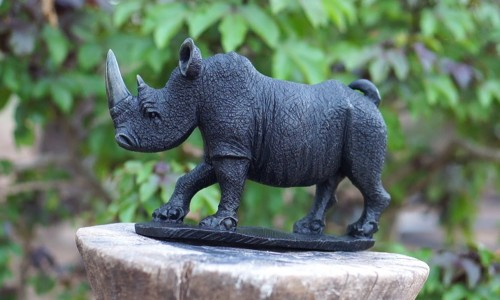 This rhino is solid, almost a foot and a half long, ten inches high. $125.