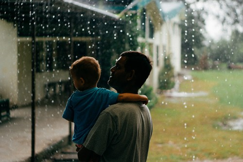 Aaron and his favorite Uncle Joey enjoying the downpour.
