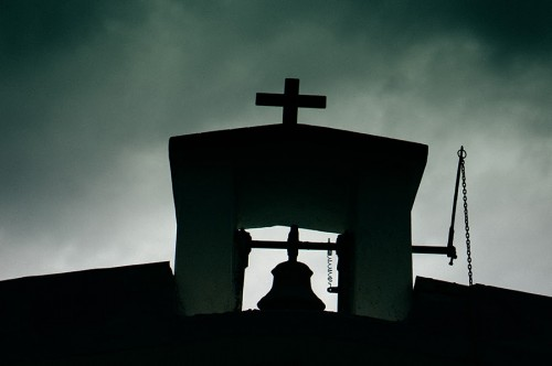 Our church steeple with dark clouds rolling in.