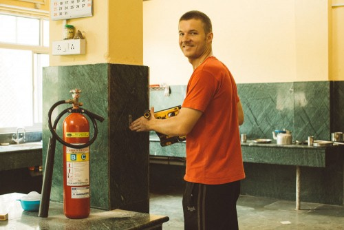 Clifton installing new CO2 fire extinguishers in the kitchen