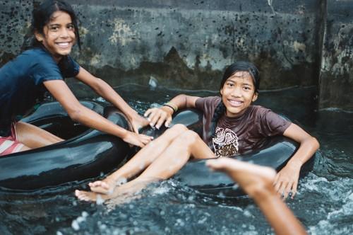 Seeya and Roshni, enjoying some tubing fun.
