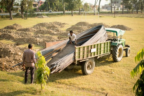 Iron for the construction being unloaded on the work site.